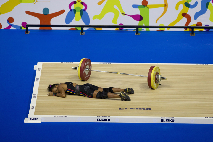 Venezuela's Genesis Rodriguez Gomez collapses during a lift attempt in the women's 53kg weightlifting at the Pan Am Games in Oshawa, Ontario, Sunday, July 12, 2015. Rodriguez took silver in the event.(AP Photo/Rebecca Blackwell)